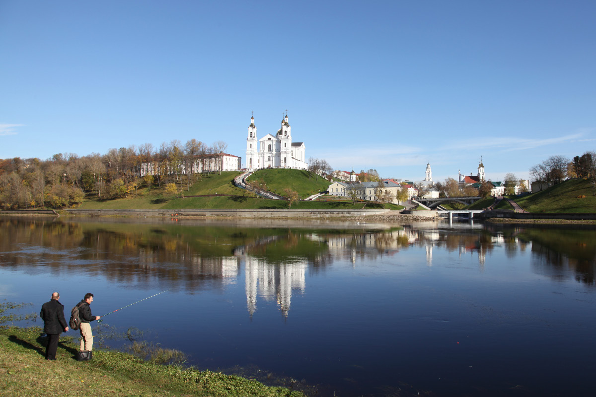 on 18 October 2012 view of Dormition Cathedral across the Western Dvina River and fishermen