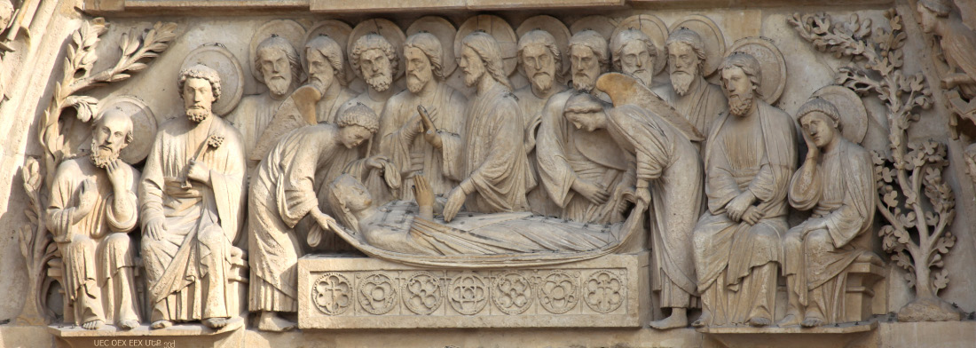 Dormition and Assumption of the Blessed Ever Virgin Theotokos Mary depicted on the fasade of Notre Dame de Paris