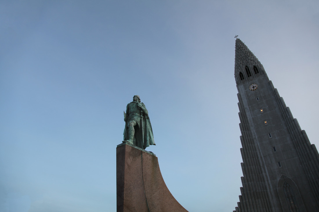 Hallgrímskirkja and Leifr Eiríksson sculpture by A.S. Calder with Cross and sword and battleaxe —  the Old Evangelization