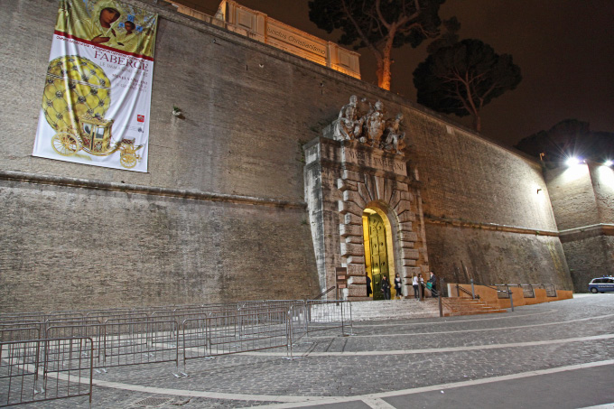 Grand entrance now an exit to Vatican Museums through great big thick wall
